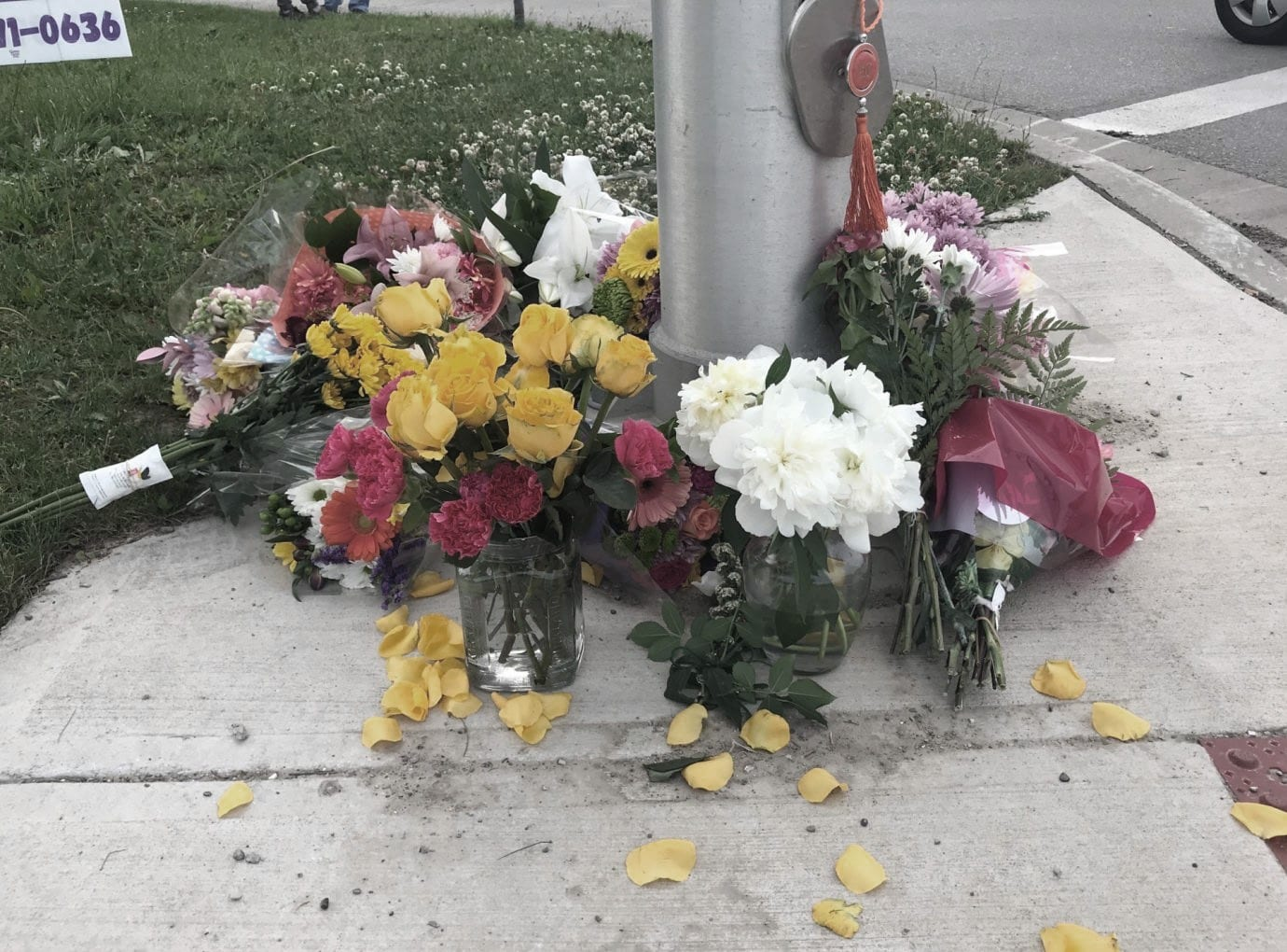 flowers around a vigil for the london family